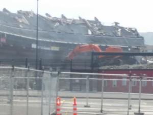 Ironic orange monsters destroying old orange and black's stadium